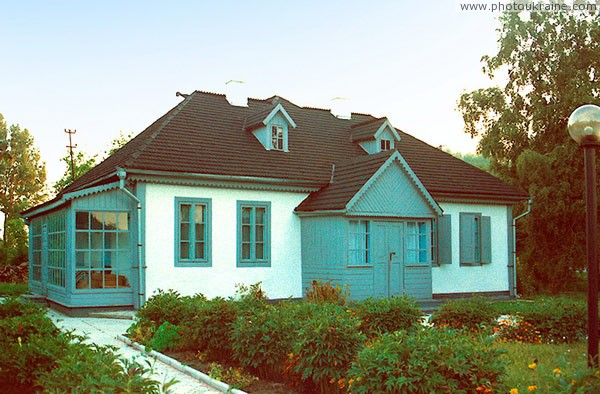 Kolodyazhne. Gray house of museum L. Ukrainka Volyn Region Ukraine photos