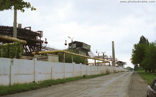 Amvrosiivka. Long fence of cement plant Donetsk Region Ukraine photos