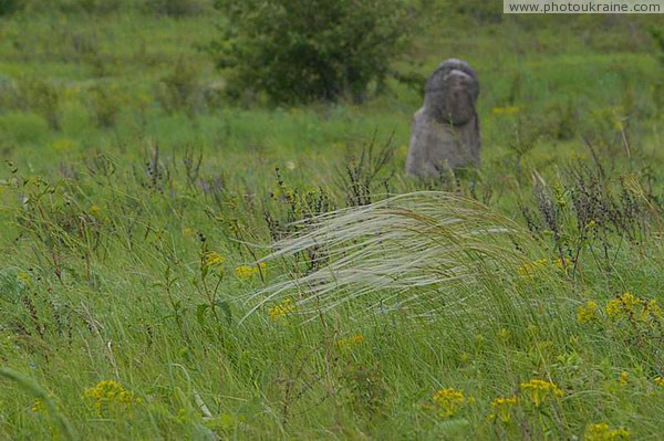 Kamiani Mohyly Reserve. Feather and woman Donetsk Region Ukraine photos