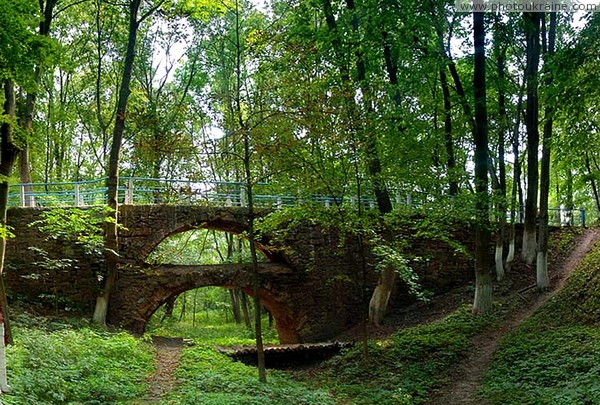 Verkhivnia. Two-storey arched bridge park Zhytomyr Region Ukraine photos
