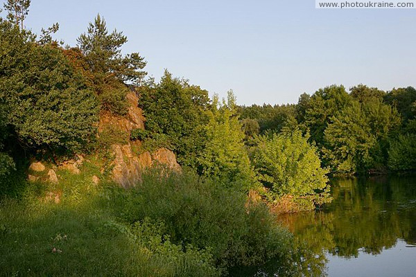 Vysokyi Kamin. High stone cliff at sunset Zhytomyr Region Ukraine photos