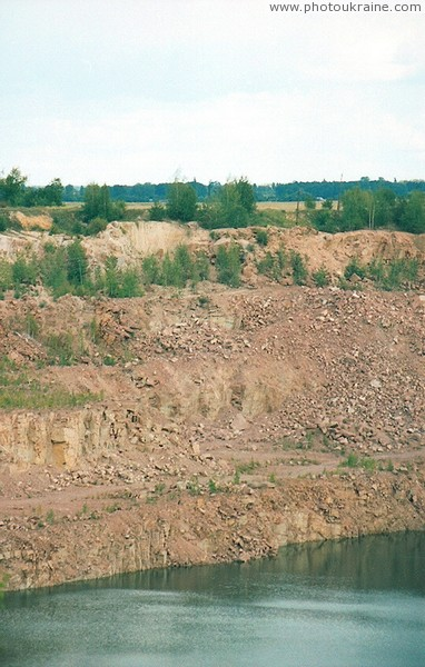 Lyznyk. Ledges of granite quarry Zhytomyr Region Ukraine photos