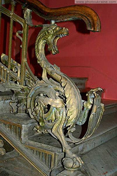 Nova Chortoryia. Forged dragon guards stairs Zhytomyr Region Ukraine photos