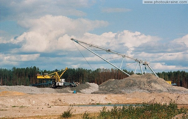 Brown coal mining in valley of river Irsha Zhytomyr Region Ukraine photos