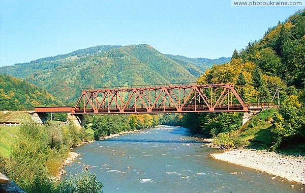 Dilove. Railway crossing river Tisa Zakarpattia Region Ukraine photos