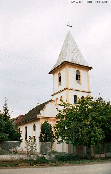 Bene. Church in village center Zakarpattia Region Ukraine photos