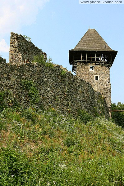 Nevytske. South tower and castle wall Nevytske Zakarpattia Region Ukraine photos