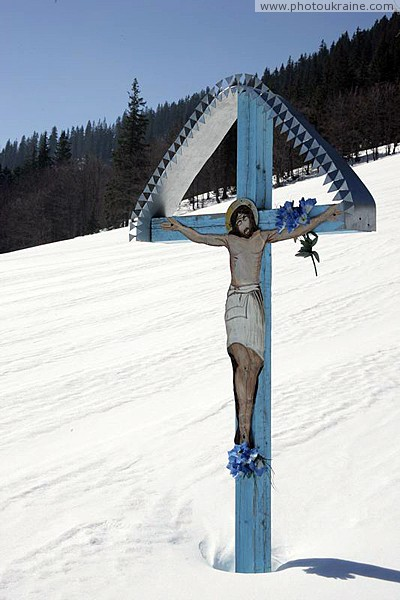 Reserve Synevyr. Crucifix on side of Gorgany Zakarpattia Region Ukraine photos