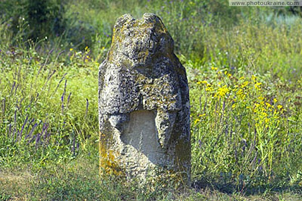 Terpinnia. Torn time stone idol Zaporizhzhia Region Ukraine photos