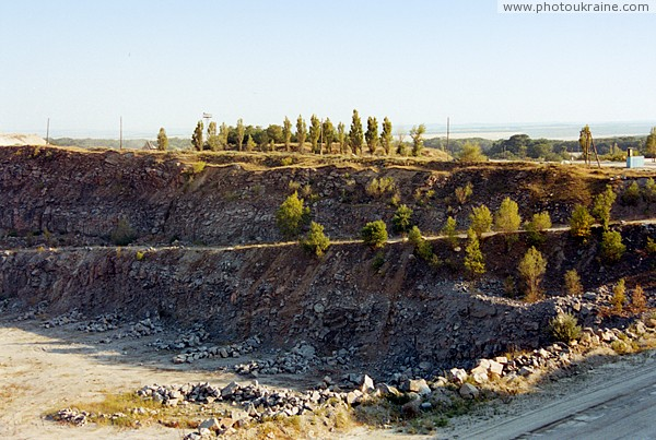 Trudove. Sloping entry into granite quarry Zaporizhzhia Region Ukraine photos