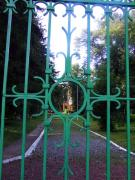 Turchynivka. Through bars of front gate of estate, Zhytomyr Region, Country Estates
