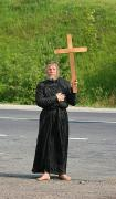 Barefoot pilgrim on road at Mount Grey Kichera, Zakarpattia Region, Peoples