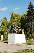 Prymorsk. Monument to tractor – toiler fields, Zaporizhzhia Region, Monuments