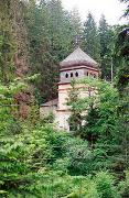 Maniavsky monastery. Gate tower bell tower in the forest, Ivano-Frankivsk Region, Monasteries