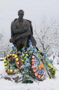 Staryi Ugryniv. Covered with wreaths monument of S. Bandera, Ivano-Frankivsk Region, Monuments
